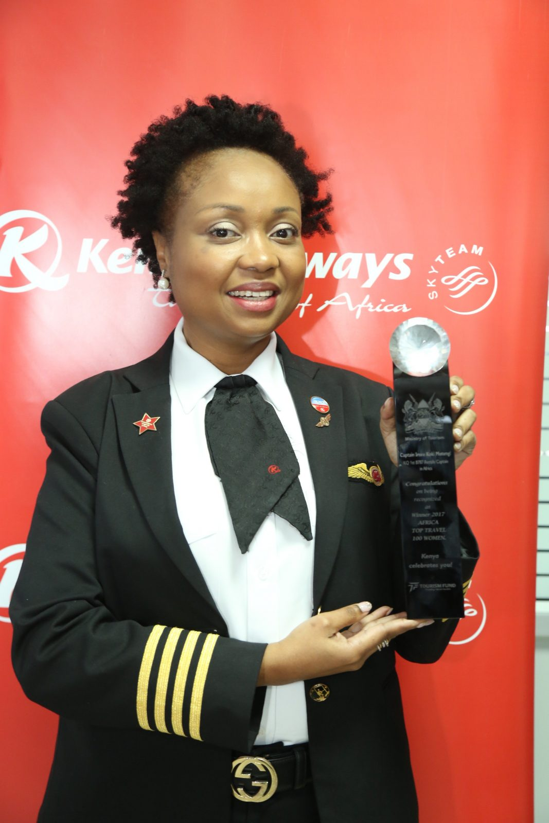 Cpt. Irene Koki Mutungi with KQ's COO Jan De Vegt and Director Flight Operations Cpt. Njoroge